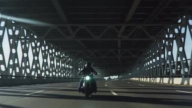 Motorcycle On The City Bridge: Stock Video