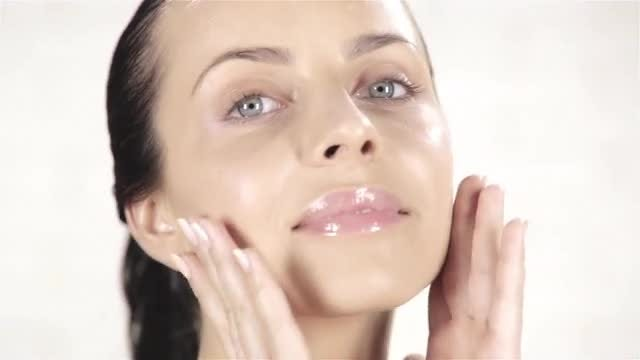 Woman Touching Face: Stock Video