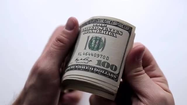 A Man Counts Money In Hands: Stock Video