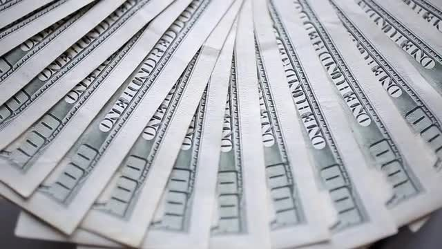 Dollar Bills On Rotating Table: Stock Video