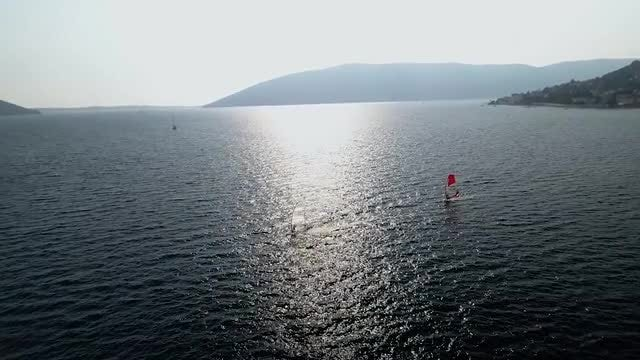 Windsurfers Surfing On The Lake: Stock Video