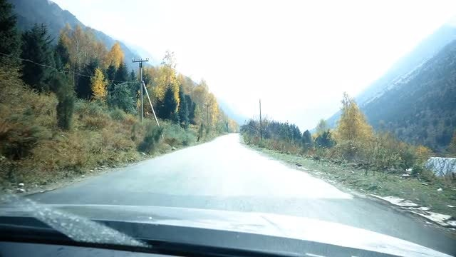 Driving Up The Snowy Mountains: Stock Video