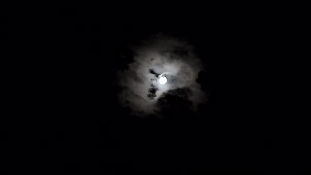 Moon Streaking Through Night Sky: Stock Video