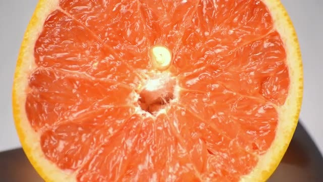 Piece Of Delicious Grapefruit Rotating: Stock Video