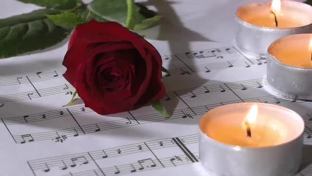 Burning Candles On Music Notes: Stock Video