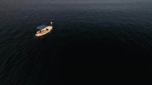 Aerial Shot Of Small Boat: Stock Video