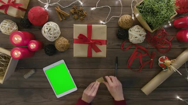 Checking Tablet For Gift Preparation: Stock Video