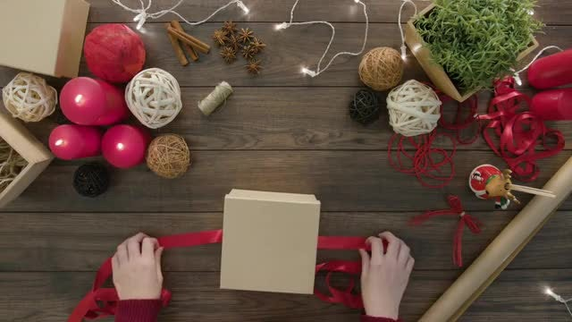Woman Wrapping Christmas Gift Box: Stock Video