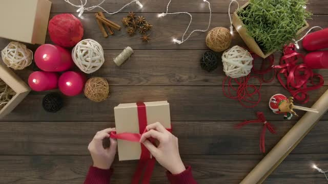 Woman Wrapping A Christmas Gift: Stock Video