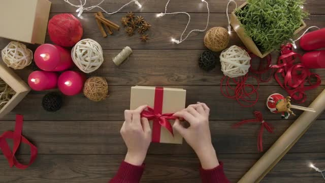 Wrapping A Christmas Gift Box: Stock Video
