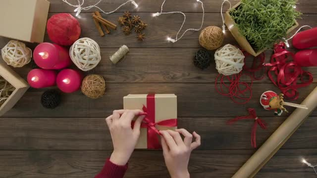 Woman Tying A Gift Box: Stock Video