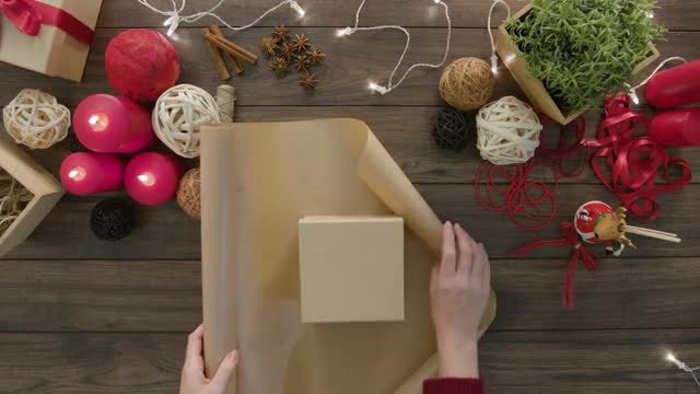 Woman Wrapping A Gift: Stock Video