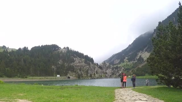 Hikers Walking By The Lake: Stock Video