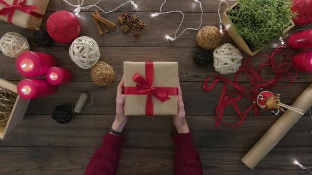 Placing Gift On The Table: Stock Video