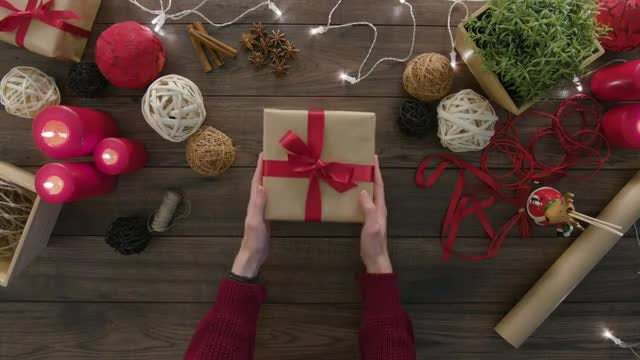 Woman Picking Christmas Gift Box: Stock Video