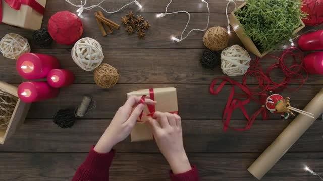 Tying Ribbon Around Gift Box: Stock Video