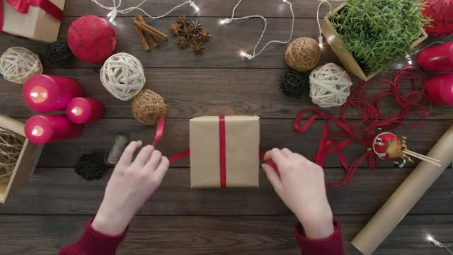 Woman Ties A Gift Box: Stock Video