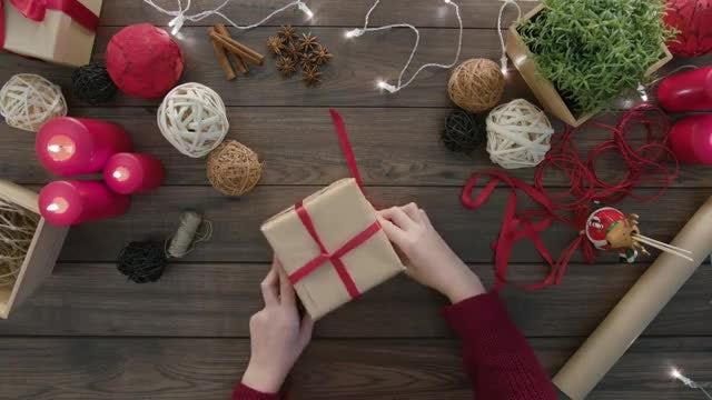Woman Wraps A Gift Box: Stock Video