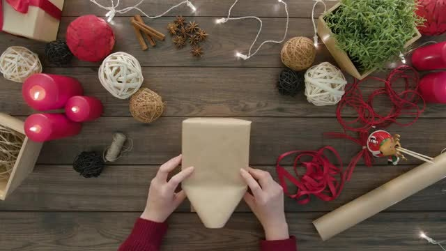 Lady Wrapping A Gift Box: Stock Video