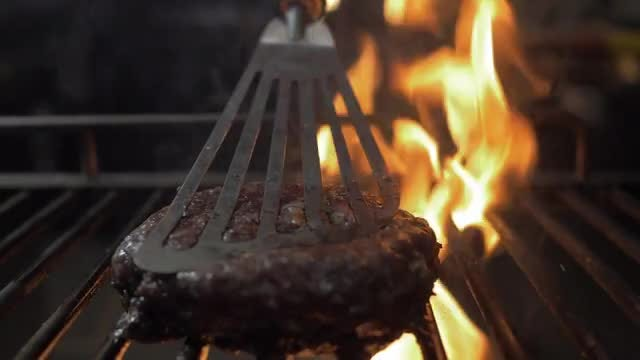 Beef Steak Pressed With Spatula: Stock Video
