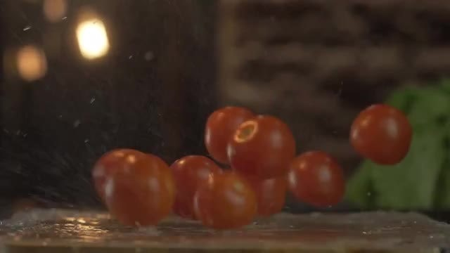 Tomatoes Falling On Wet Table: Stock Video