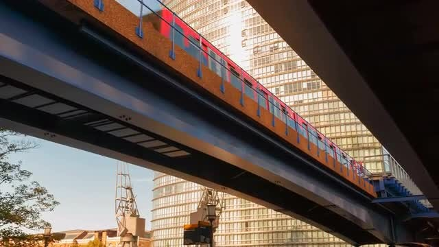 Light Train Crossing A Bridge: Stock Video