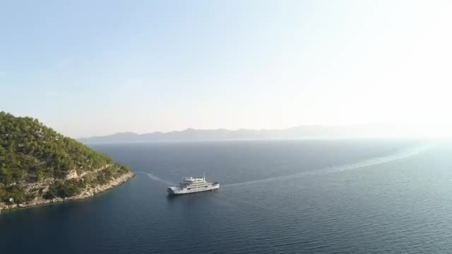 Aerial Shot Of Yacht Cruising: Stock Video