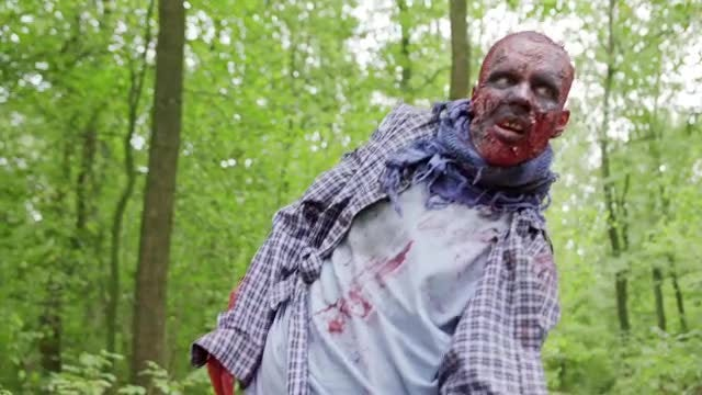Male Zombie Drags Through Woods: Stock Video