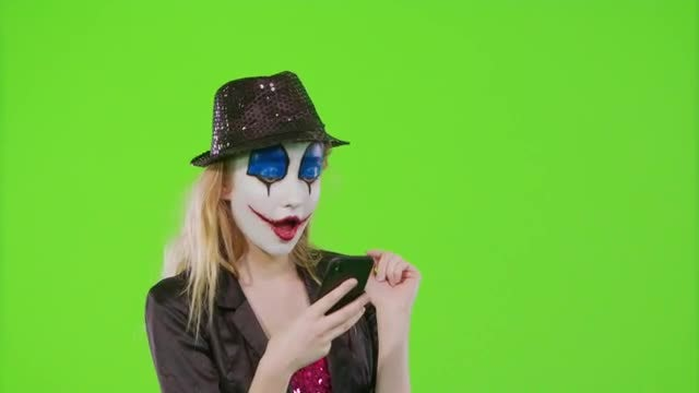 Halloween Lady Mime Surfing Phone: Stock Video
