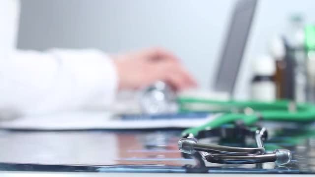 Doctor Typing On A Laptop: Stock Video