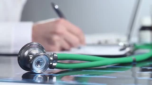 Doctor Working On A Laptop: Stock Video