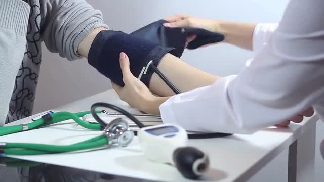 Doctor Measuring BP With Sphygmomanometer: Stock Video