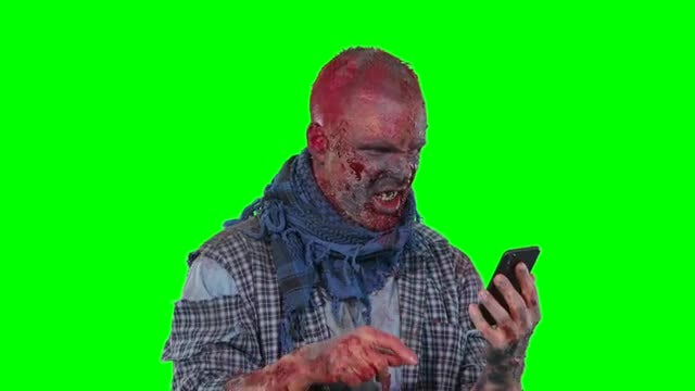 Zombie On Green Screen Texting: Stock Video