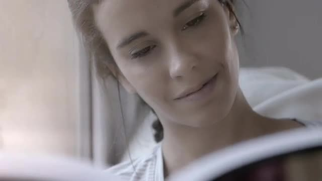 Woman Reading By Window: Stock Video