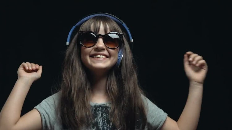 Young Cute Girl With Headphones: Stock Video
