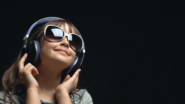 Closeup Of Girl With Headphones: Stock Video