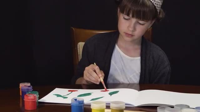 Girl Painting On White Paper: Stock Video