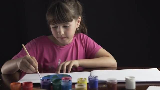 Girl Painting Planet Earth: Stock Video