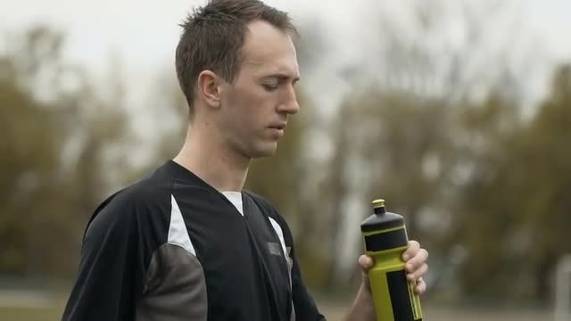 Jogger Drinking Water From Bottle: Stock Video