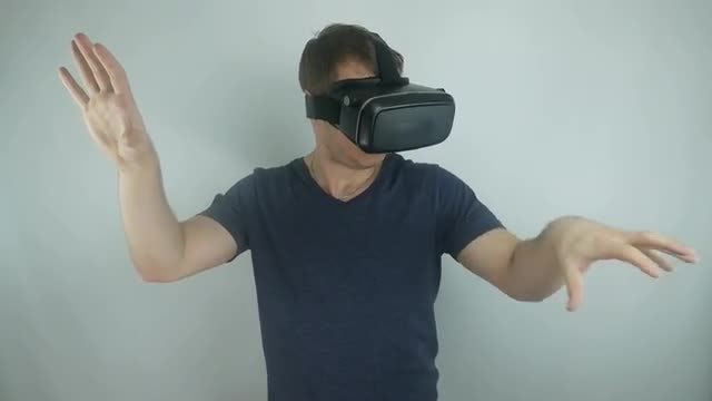 Man Testing Virtual Reality Helmet: Stock Video