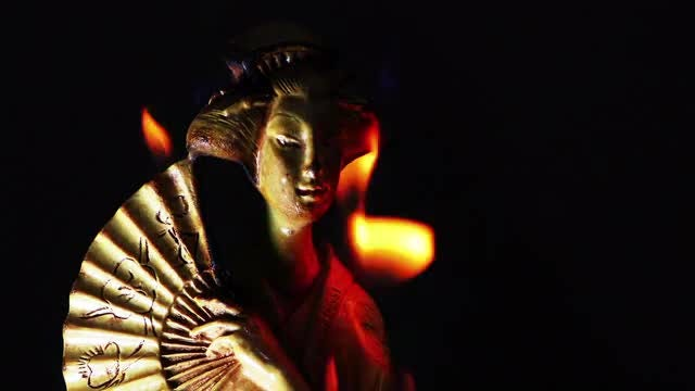 Japanese Girl Statue Catches Fire: Stock Video