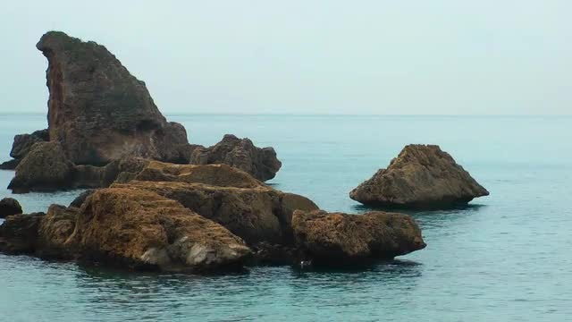 Rocks On Light Blue Sea: Stock Video