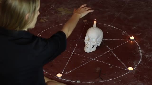 Witch Performing Occult Spell: Stock Video