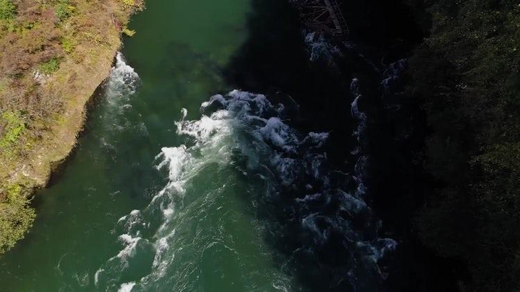 Water Gushing Over Broken Bridge: Stock Video