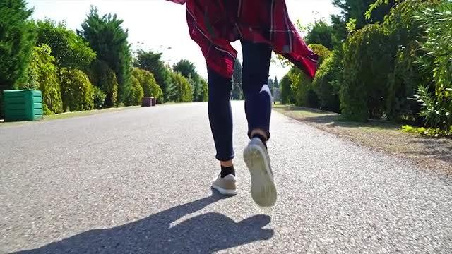 Woman Walking On Empty Street: Stock Video