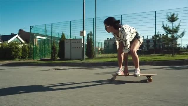 Teenage Girl In Sunglasses Skating: Stock Video