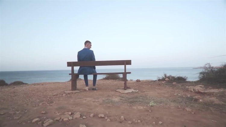 Man Sitting On A Bench: Stock Video