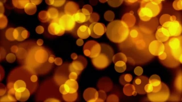 Smoldering Gold Bokeh Background: Stock Motion Graphics