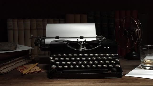 Old Typewriter In Dark Room: Stock Video