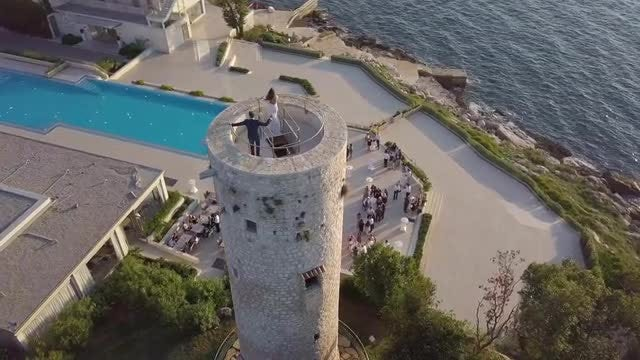 Aerial Shot Of A Couple On The Old Lighthouse: Stock Video